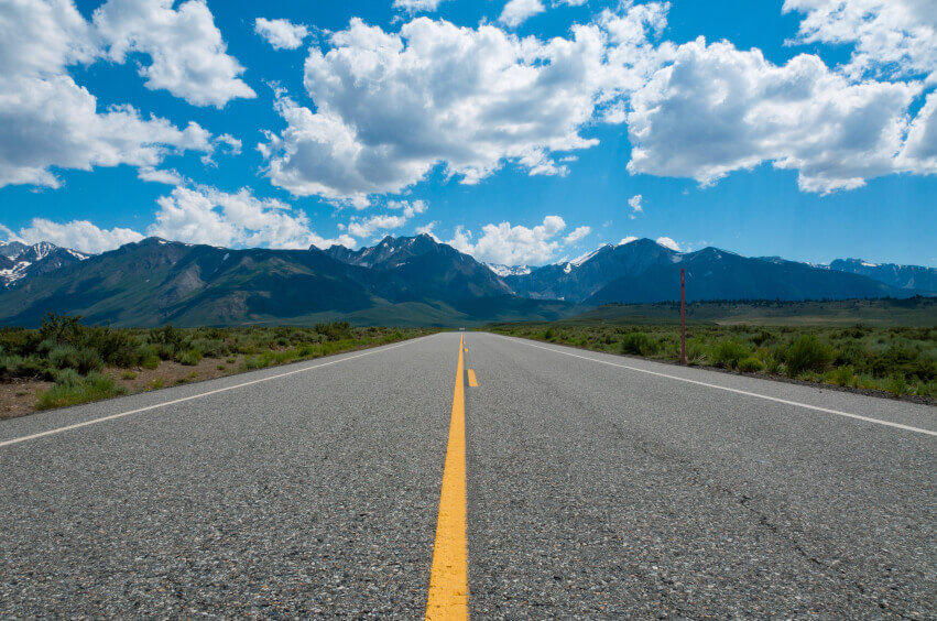 Free road with mountains in background