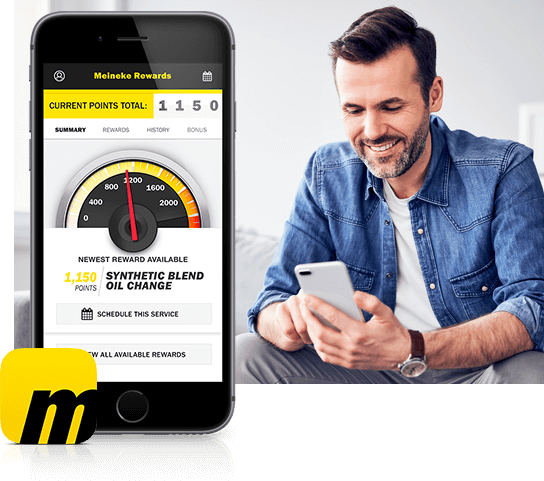 Image of Meineke app Rewards screen and man looking at the app on his phone